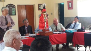 Chairman SRA Nepal assisted by Pokhara Branch Chairman opens the meeting with a khada of the Replica of the Queen's Truncheon